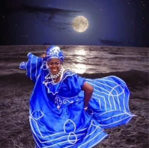 Yemaya is the Goddess of the Ocean and she dresses in blue and white color and dances imitating the movements of the waves in the ocean